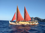 Hōkūleʻa sailing in front of Nihoa.