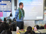 Daniel Wagner presenting to 4th grade students at Island Pacific Academy.