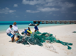 The Marine Debris Team hauls discarded fishing nets for removal at Midway Atoll.