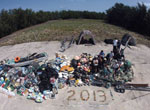 13,795-kg pile of derelict fishing gear and plastic debris.
