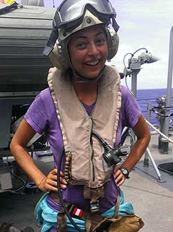 Megan Dalton prepared to get on an Osprey to Midway Island.