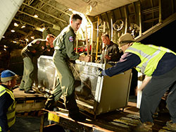Two female Hawaiian monk seals are returned to the Northwestern Hawaiian Islands.U.S. Coast Guard crew members load the seals onto the HC-130 for transport.