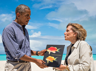 Famed undersea explorer Sylvia Earle presents President Obama with a picture of the fish that bears his name during his visit to Midway Atoll in September 2016.