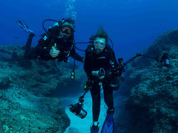 Dr. Sylvia Earle and Wyland share their first dive together at Midway Atoll National Wildlife Refuge.