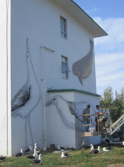 Wyland is seen working on one of his murals.