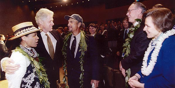 President Bill Clinton, Buzzy Agard, Tammy and Isaac Harp, and Sylvia Earle at the announcement of the Executive Order establishing the Northwestern Hawaiian Islands Coral Reef Ecosystem Reserve in 2001 at the National Geographic Society headquarters in Washington, DC.